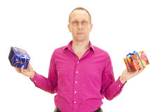 Business person juggling with two colorful gifts. A business person juggling with two colorful gifts Stock Photography