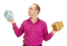 Business person juggling with two colorful gifts. A business person juggling with two colorful gifts Stock Photo
