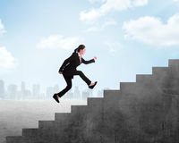 Business person jump to the highest stair Stock Images
