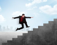 Business person jump to the highest stair Royalty Free Stock Image