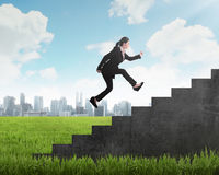 Business person jump to the highest stair Stock Photography