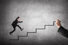 Business person jump to the highest stair Royalty Free Stock Photography