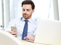Business person looking at cellphone Royalty Free Stock Photos
