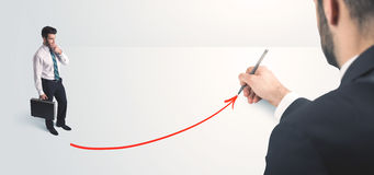 Business person looking at line drawn by hand Stock Photography