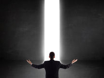 Business person looking at wall with light tunnel opening Stock Image