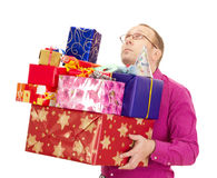 Business person with a lot of gifts Stock Images