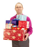 Business person with a lot of gifts Stock Photo