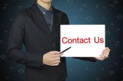 Business person pointing contact us. Stock Image