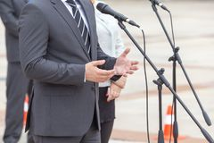 Politician is giving a speech. Political rally. Royalty Free Stock Photo