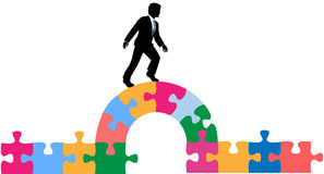 Business person puzzle bridge to solution Royalty Free Stock Photos