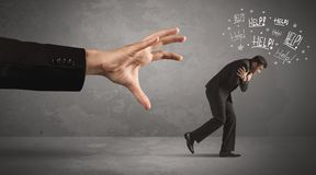 Business person running away from big hand royalty free stock photography