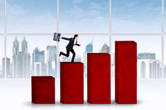 Business person runs above chart Stock Images