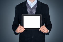 Business person showing blank apple ipad Stock Photos