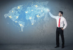 Business person showing digital map with planes around the world Royalty Free Stock Photos