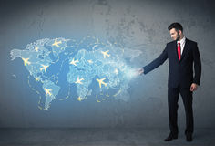 Business person showing digital map with planes around the world Royalty Free Stock Photography