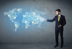 Business person showing digital map with planes around the world Stock Images