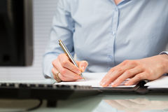 Business Person Signs a Contract Stock Image