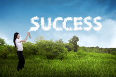 Business person spraying bottle of aerosol create word success Stock Photo