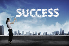Business person spraying bottle of aerosol create word success Stock Photography