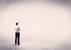 Business person standing in empty space Royalty Free Stock Image