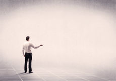 Business person standing in empty space Royalty Free Stock Photography