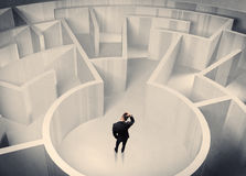 Business person standing in maze center Royalty Free Stock Photo
