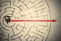 Business person standing in the middle of a circular maze Stock Photography