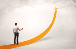 Business person standing on orange arrow Royalty Free Stock Photos