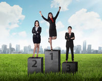 Business person standing on the podium Royalty Free Stock Photo