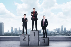 Business person standing on the podium Royalty Free Stock Photos