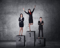 Business person standing on the podium Royalty Free Stock Image