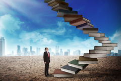 Business person step up flying book that look like stair Royalty Free Stock Photo