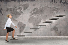 Business person stepping up a staircase. Business concept Stock Photos