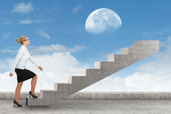 Business person stepping up a staircase. Business concept Royalty Free Stock Photo