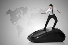 Business person surfing with computer mouse. Asian business person surfing with computer mouse royalty free stock image