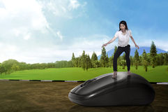 Business person surfing with computer mouse Royalty Free Stock Photography