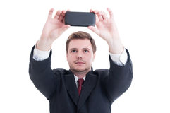 Business person taking a selfie using phone camera or smartphone Royalty Free Stock Image