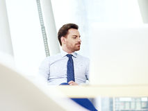 Business person thinking in office Stock Photo