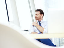 Business person thinking in office Stock Image