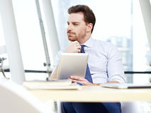 Business person thinking in office Royalty Free Stock Photo
