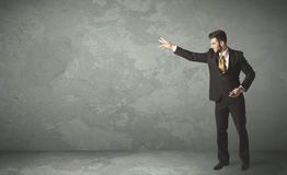 Business person throwing with empty copyspace. In a room Stock Photos