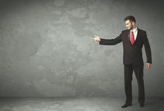 Business person throwing with empty copyspace. In a room Royalty Free Stock Photos