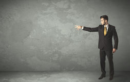 Business person throwing with empty copyspace. In a room Royalty Free Stock Images