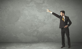 Business person throwing with empty copyspace. In a room Royalty Free Stock Photo