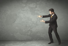 Business person throwing with empty copyspace. In a room Stock Photo