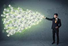 Business person throwing a lot of dollar bills concept Royalty Free Stock Photos