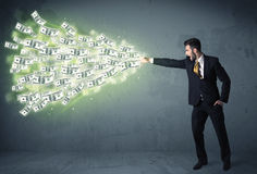 Business person throwing a lot of dollar bills concept Stock Photos