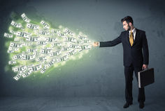 Business person throwing a lot of dollar bills concept Royalty Free Stock Photo
