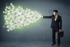 Business person throwing a lot of dollar bills concept Stock Image
