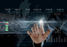 Business person touching charts and diagrams stock market. On dark background stock images